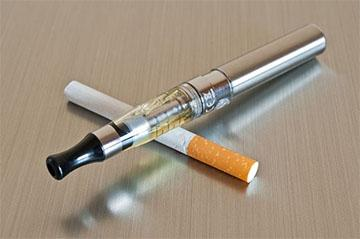 photo of cigarette and vaping device