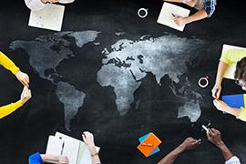 people working around a world map