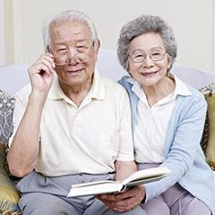 senior asian couple reading a book together at home. click for more: afamiliesai